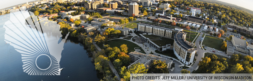 An arial shot of UW–Madison campus and the shore of lake Mendota