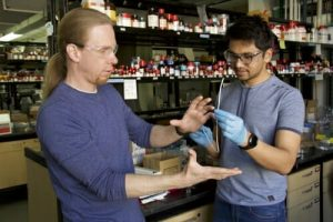 David Lynn and Harshit Agarwal standing in a lab