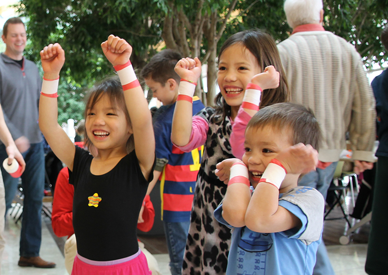 Children putting their hands in the air