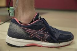 A person wearing a running shoe