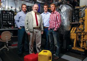 Reed Hanson, Rolf Reitz, Derek Splitter and Sage Kokjohn standing together in a workshop