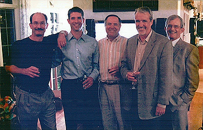 Five people standing shoulder to shoulder in 2008