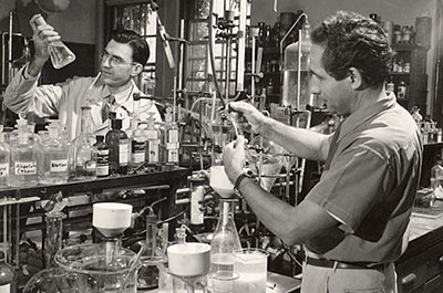 Two men in a lab in the 1950s